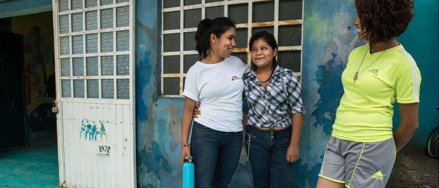 MSF psychologist Nadia Rivera, with two of her young patients, both survivors of sexual violence in Honduras.